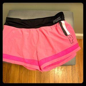 Victoria's Secret pink jogging shorts.